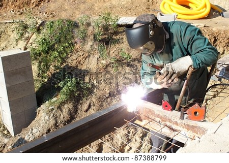 welder working outside in the metal construction