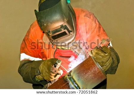 Welder works sparkle