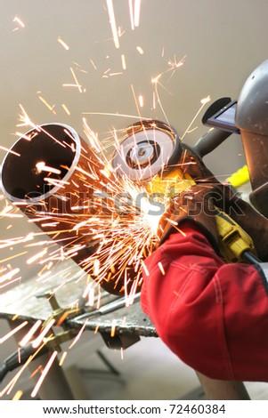 Welder works sparkle