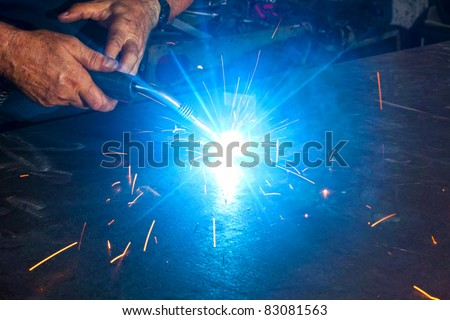 welding close-up bright light and two hands working