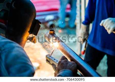 Welding Man In Construction Site - Shutterstock ID 706430095
