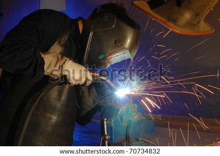 Welding man - man at work