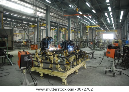 welding operators are working on factory