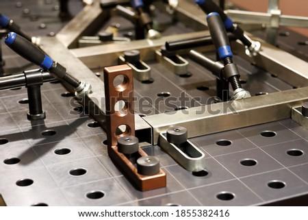 Welding platen table with fixtures and jig design. Selective focus. Stockfoto ©
