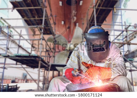 Photo of  Welding process ship repair at floating dry dock in shipyard