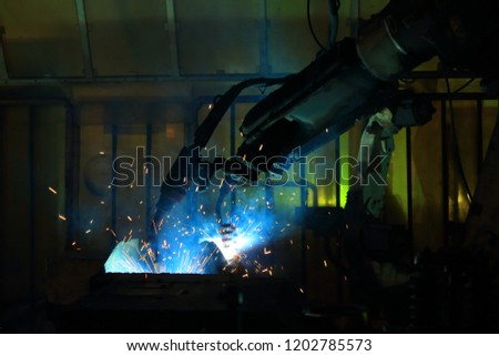 welding robot are working in automotive industry  #1202785573
