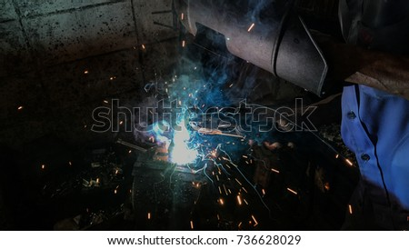 Welding , spark and smoke caused by welding in production process #736628029