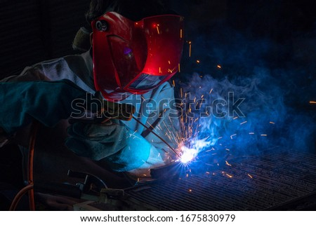 Welding steel industry worker work steel weld spark, Industrial workers are welding steel Classified as a steel industry Personnel should pay attention to safety at work.