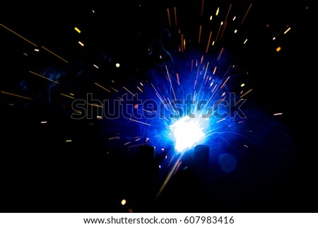 Welding steel with sparks #607983416