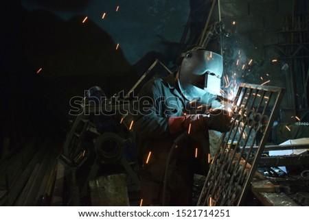 welding welder forge smithy spark work worker productions industry smoke