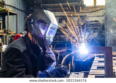 Welding work in an electromechanical workshop at a mechanical assembly site. Photo stock ©