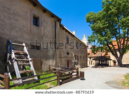 Well and instrument of torture on courtyard of the  medieval Krivoklat Castle in Czech Republic ( central Bohemia, near Prague ) - stock photo