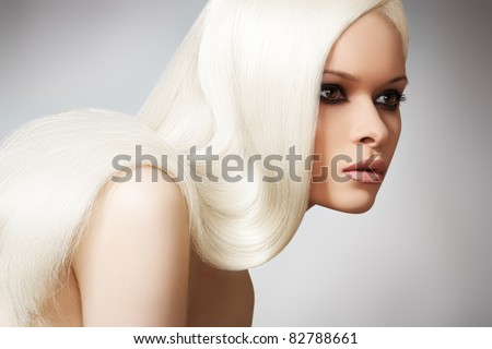 Well-being & spa. Sensual woman model with shiny straight long blond hair and chic evening make-up. Health, beauty, wellness, haircare, cosmetics and make-up. Beautiful fashion platinum hairstyle