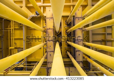 Well casing and well slot, pipe work at drain deck of oil and gas remote platform.