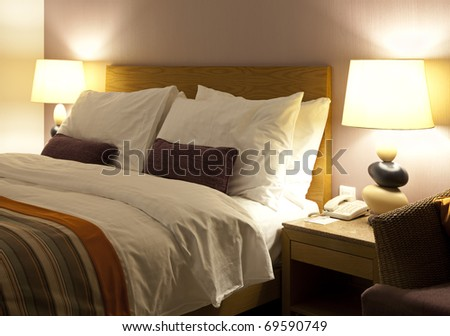 Well decorated hotel bedroom in soft lights