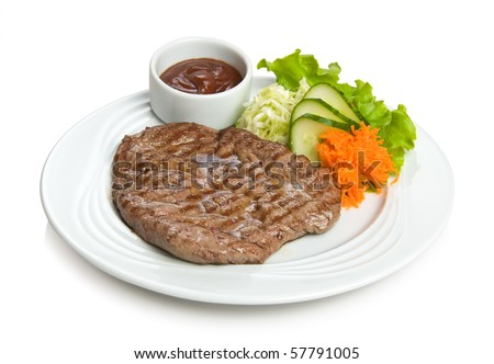 steak with vegetable side dish
