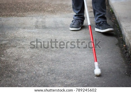 Well Dressed Blind Man Walking Near a Curb with a Long White Cane; Close up on Cane and Feet (Copy Space) #789245602