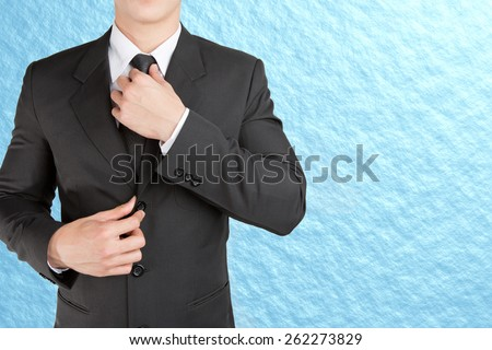 Well dressed businessman looklike smart adjusting  his neck tie on sky background : fill text