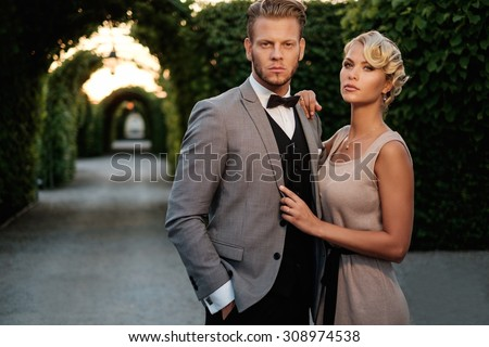 Well-dressed couple in a beautiful alley  Stock photo ©