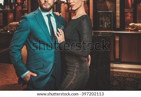 Well-dressed couple in luxury apartment interior. #397202113