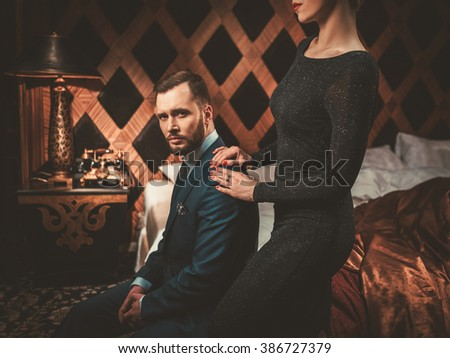 well dressed couple in luxury...