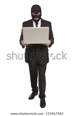 Well dressed criminal holds a laptop computer