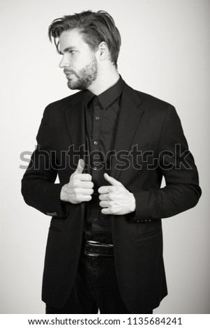 Well dressed male fixing his suite #1135684241