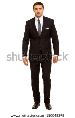 Well-dressed man in suit and tie. Charismatic businessman standing on white background Stock photo ©