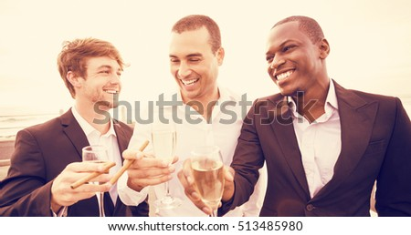 Well dressed men drinking champagne next to limousine on night out #513485980