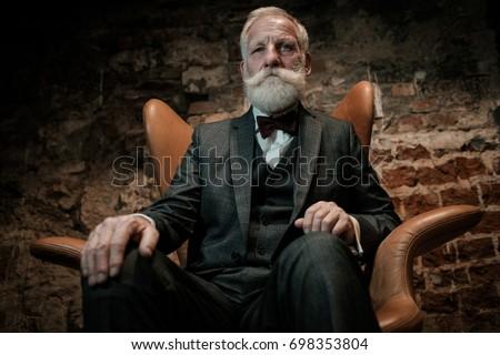 well dressed senior man in...