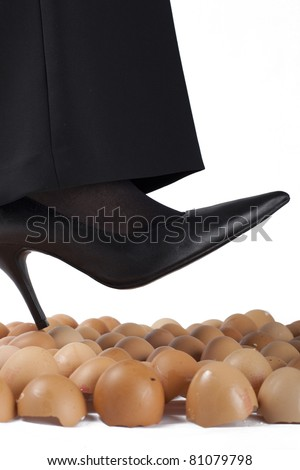 Well dressed woman walking on egg shells, white background.