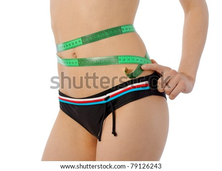 well female body with tape measurer over slim waist