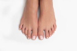 Well-groomed feet isolated on white background.
