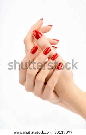 Well-groomed female hands with the beautiful manicure, isolated