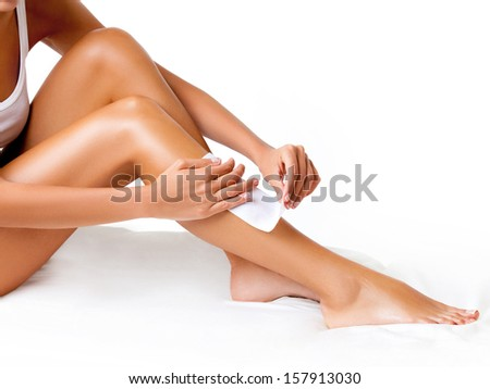 Well-groomed Woman Legs After Depilation Isolated on White Background