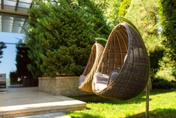 Well-kept green garden. Great cozy place to stay. Wicker Chair Nest.