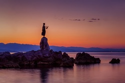 Well known statue of a girl holding a seagull in Opatija, Croatia