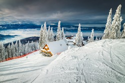 Well known winter ski resort with slopes in Romania. Stunning touristic and winter holiday destination. Winter cloudy day in Poiana Brasov ski resort, Transylvania, Romania, Europe