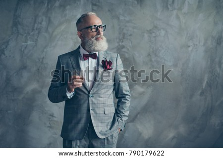 Well-off luxurious lifestyle. Portrait of confident respectable planning handsome brutal masculine sharp-dressed checkered grey tux vinous handkerchief drinking beverage isolated on background