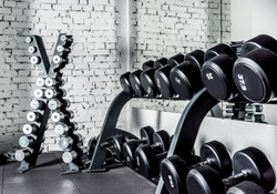 Well-ordered weight training equipment in modern sports club