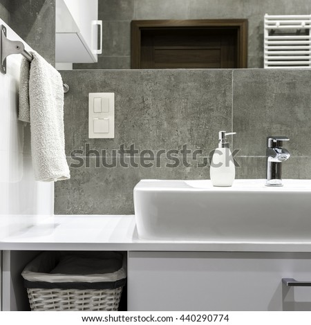 Well organized modern bathroom with white towels