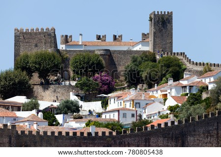 Well-preserved medieval hilltop Castle of Obidos located in the Portuguese district of Leiria. #780805438