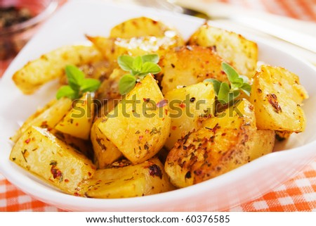 Well spiced roasted potato in white bowl