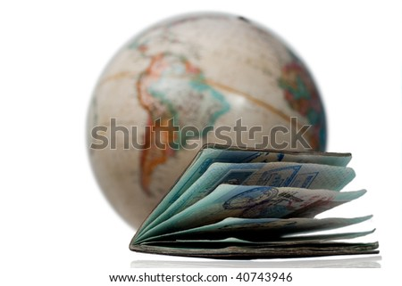 Well traveled passport with many stamps and visas in front of a map or globe of planet earth