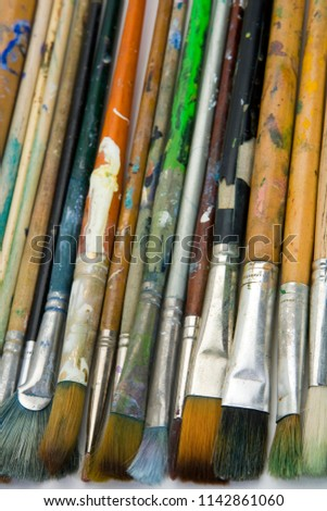 Well used artists oil painting brushes close-up background #1142861060