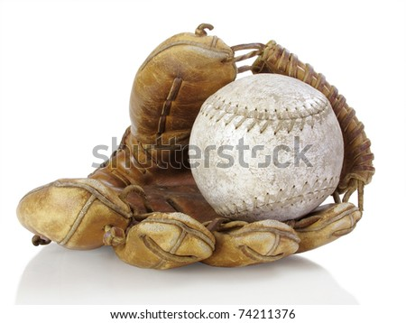 Well-used catcher's mitt with tattered softball