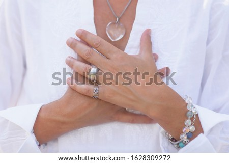 Wellbeing Coach, Middle Aged Woman Practicing Mindful Acceptance Meditation. Positive Mindset Concept ストックフォト ©