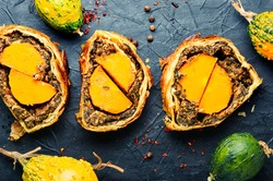 Wellington pumpkin,loaf of bread stuffed with baked mushrooms and pumpkin.