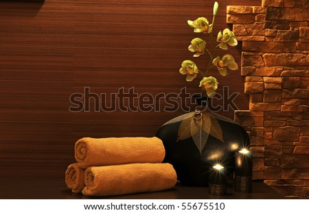 Wellness and spa concept with candles and collection of the towels.