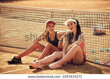 Wellness, bodycare, health, healthcare. Women athletes relax on tennis court, sport. Sport, training, workout Energy energetic activity Sexy women training outdoor sport #1093414271